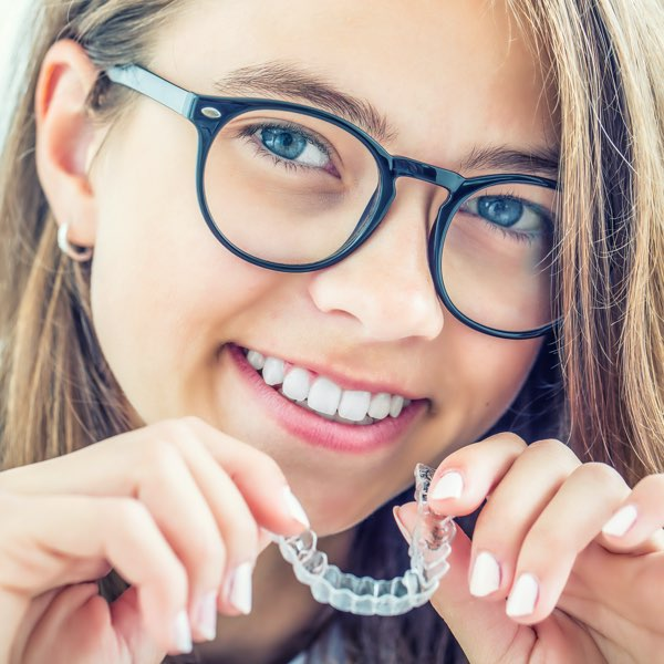 Woman holding her Invisalign